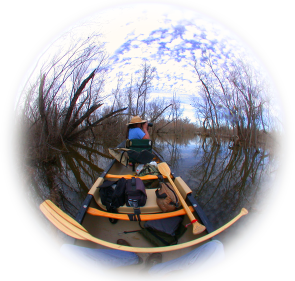 Donna Miller shooting photographs from an Old Town Canoe in Texas waters